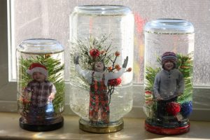 kids-in-snow-globes-on-window